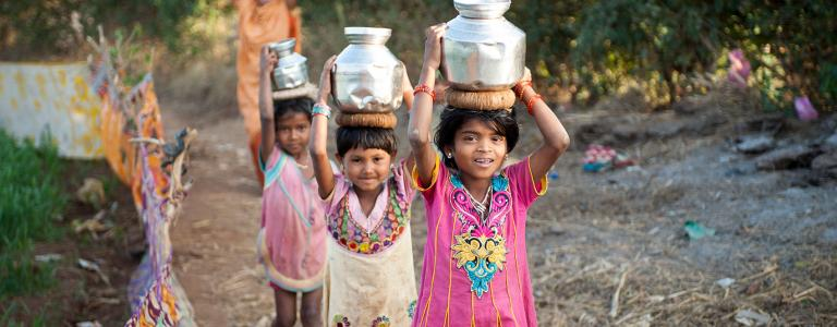 Asian girls carrying water for miles in a global clean water crisis - KP Yohannan - Gospel for Asia