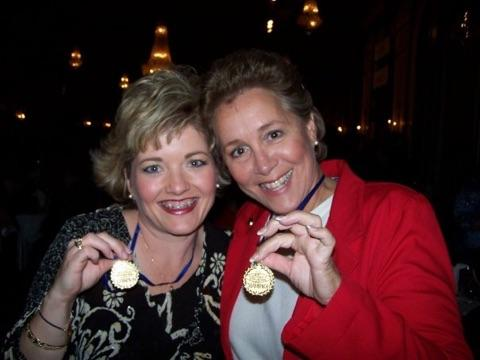 Two women with gold medals