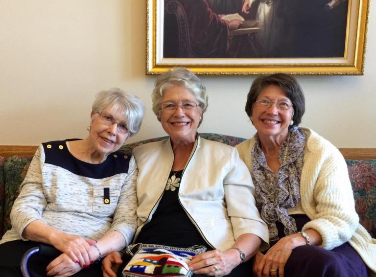 3 sisters on a couch Carol