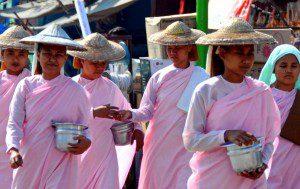 Burmese nuns on alms rounds, Burma 2011