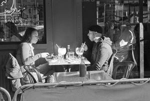 cafe couple with big drinks, photo by Susan Sermonetta (cc) 2007.