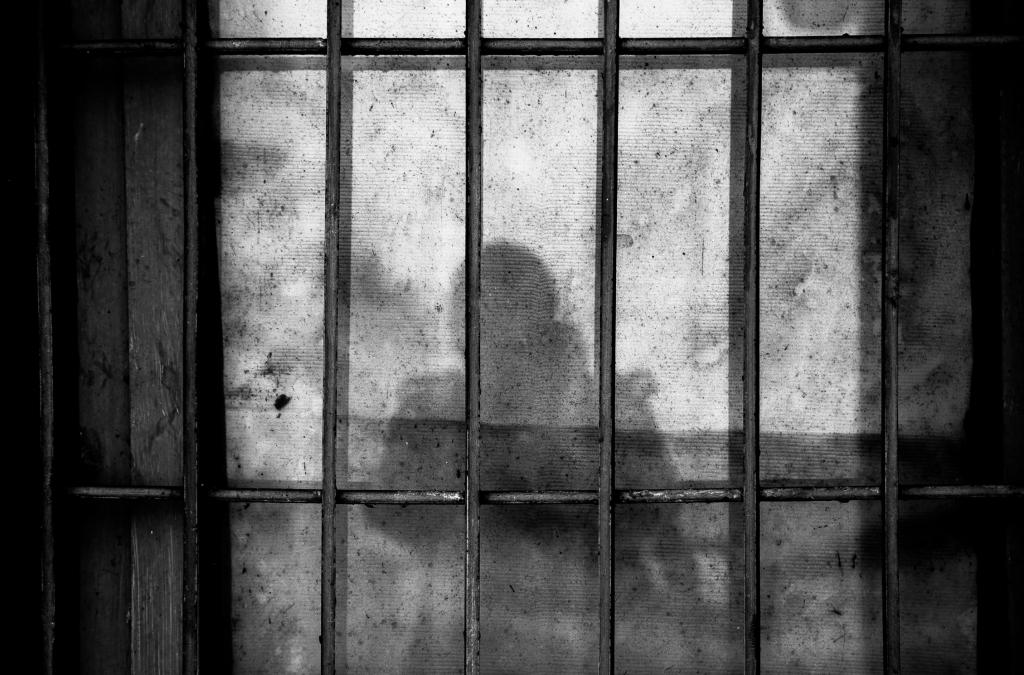 shadow in prison Photo by Ye Jinghan on Unsplash