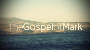 """""""The Gospel of Mark"""" and the Sea of Galilee in the background."""