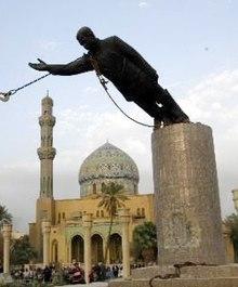 Statue of Saddam Hussein coming down.