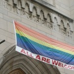"Oddly, many evangelicals would gladly hang an ""All Are Welcome"" banner on their churches, but not one like this, attached to a rainbow flag. ""All"" doesn't always mean ""all."" And ""welcome"" doesn't always mean ""welcome."" (Photo by Drama Queen via ookaboo.)"
