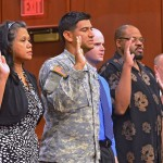 "From left: Nenita Bouchard, from Philippines, Gustavo Calix Luque, from Honduras, Michael Cumming, from Canada, Emmanual Dima, from Cameroon, and Mujo Durakovic, from Bosnia-Herzegovina, take the Oath of Allegiance for new United States citizens in June in Syracuse, N.Y. That oath, by law, includes the phrase ""so help me God."" It shouldn't. (Photo by Dick Blume of The (Syracuse) Post Standard.)"