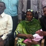 Meriam Ibrahim with her son, husband Daniel Wani (right), lawyer Mohanad Mustafa (left). Getty Images photo via The Guardian article at link.