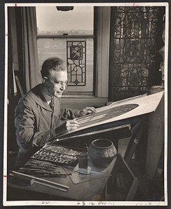 Wilbur Burnham designing a stained glass window