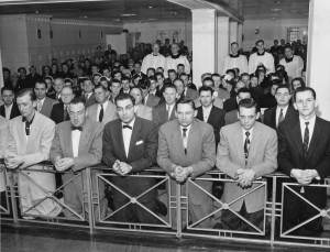 CATHOLICS SHOWN KNEELING AT COMMUNION RAIL IN 1955 PHOTO