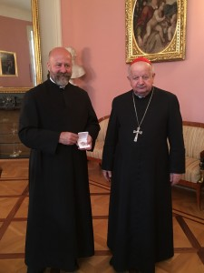 Receiving a relic of Pope St John Paul II from Cardinal Archbishop of Cracow