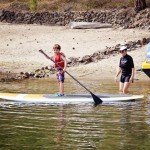 My child learning to paddle board.