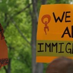 "Photo: Flickr, ""Progress"" and ""Immigration"" signs, by Takomabibelot, Creative Commons License, some changes made."