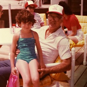 The author, age 5-6 and her grandfather Martin.