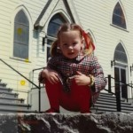 Cathleen, age 3, in front of the Roman Catholic church in Milford, N.H.