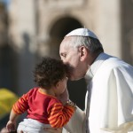 Pope Francis kissing a child