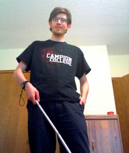 The author navigating life with his trusty cane.