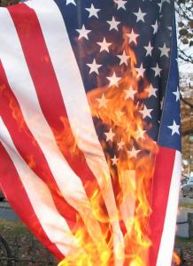 """I don't like flag burning. But Trump metaphorically """"burns"""" the flag every day with his actions. Obtained through Creative Commons."""