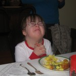Penny praying before Christmas dinner a few years ago