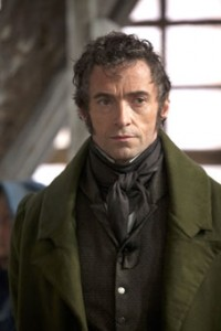 Hugh Jackman as Valjean, risen to be a businessman.