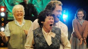 Hefina (Imelda Staunton) and Jonathan Blake (Dominic West), getting to know each other