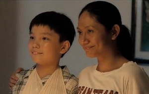 "Jiale (Koh Jia Ler) and Teresa (Angeli Bayani), in ""Ilo Ilo"""