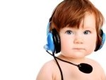 9676305-adorable-baby-girl-with-headset-microphone-isolated-over-white