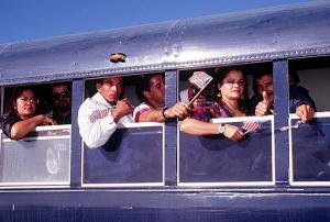 Cuban_refugees_finally_about_to_fly_from_Guantanamo_to_asylum_in_the_USA_in_September_1996
