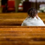 woman_praying_in_pew_small