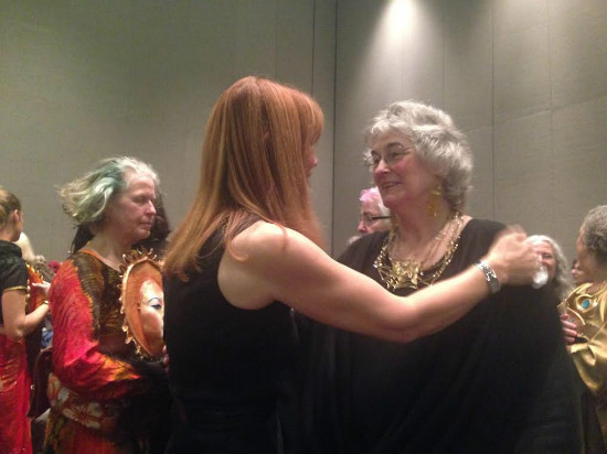 Vivianne Crowley and Aline O'Brien (Macha Nightmare) after narrating 'Goddesses Alive! A ritual with masks,' Sunday, October 18, 2015, Parliament of the World's Religions, Salt Lake City. Credit: Eblis Correllian