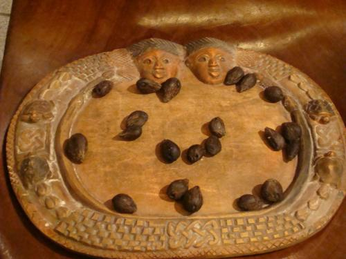 Ifa divination tray image courtesy of wikimedia commons. Licensed under CC 2.0