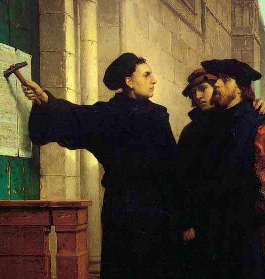 Martin Luther tacks his 95 Theses to the door at Wittenburg