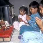 http://www.magnoliabox.com/art/250791/Hindu_children_praying_in_front_of_small_family_shrine_in_the_UK
