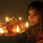 http://www.firstnews.co.uk/news-in-pictures/offbeat-news-pictures-of-the-day-i201/indian-hindu-woman-poses-with-earthen-lamps-p2546