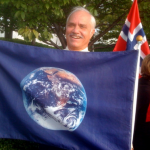 Pagan activist Patrick McCollum holding the Earth flag.