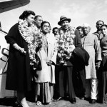 Martin Luther King Jr. and his wife, Coretta, both wearing garlands, are received by admirers in New Delhi, India, February 10, 1959. (AP Images)