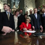 Gov. Chris Gregoire signing same-sex marriage law. Photo: Elaine Thompson/AP