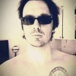 Damien Echols, showing off his Theban tattoo.