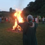 Selena Fox of Circle Sanctuary leading a Lammas bonfire ritual.
