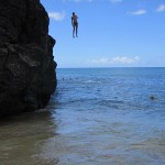 Kai leaping off the rocks at Waimea Beach--same place I love to watch 40 foot waves during the winter.